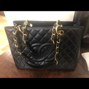 NWT. Black Chanel large tote with gold hardware